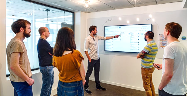 Software team having a daily stand-up meeting
