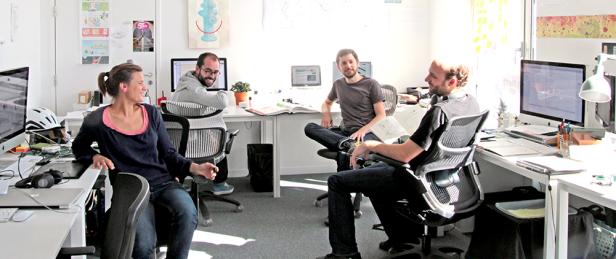 4 designers sat together working