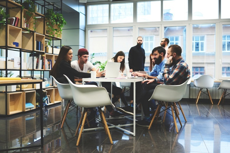 Designers talking around a table